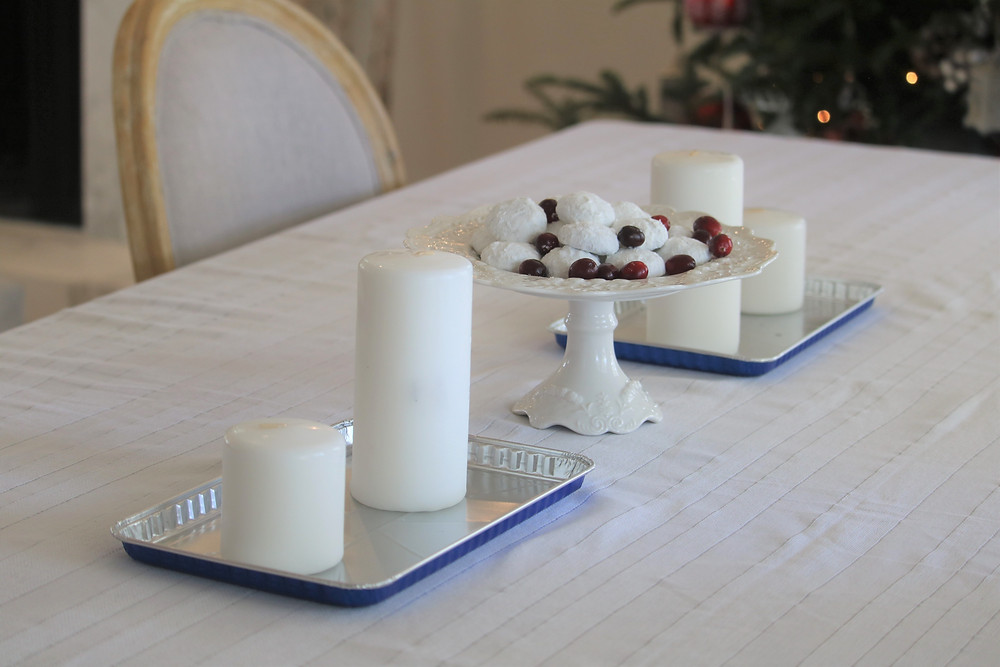 Metal trays hold the candles and protect your table cloth.