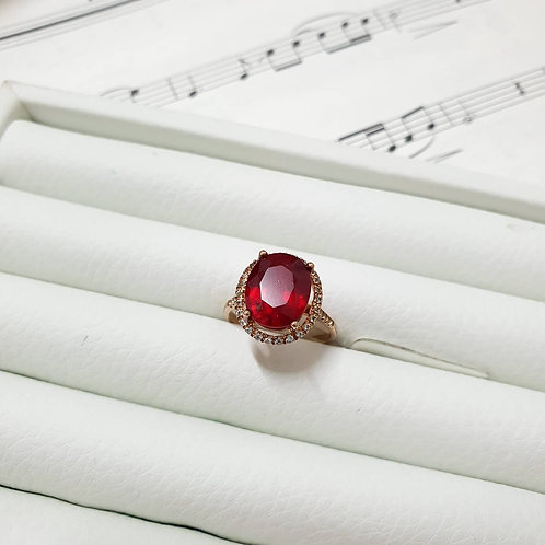 Oval ruby with white topaz halo ring rose gold tone silver