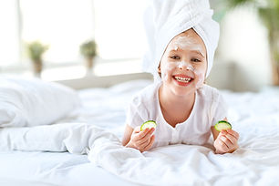 happy child girl in towel with mask on
