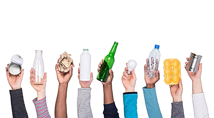 Recyclable rubbish held in hands isolate