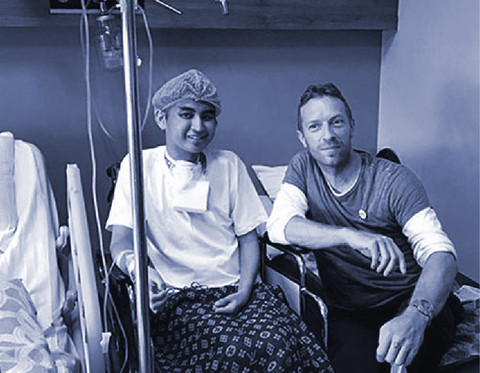 I WILL TRY TO FIX YOU Coldplay Frontman visits fan who had cancer.
