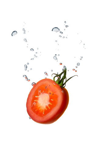 Tomato in the water with air bubbles