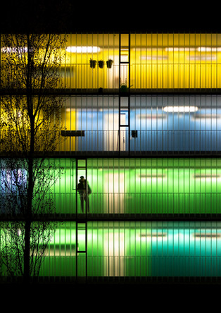 Colorfully illuminated residential building at night
