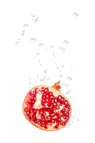 Pomegranate in the water with air bubbles