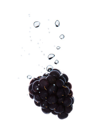 Blackberry in the water with air bubbles