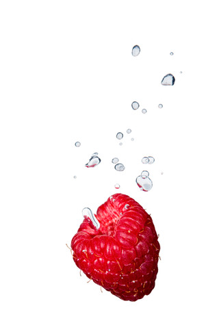 Raspberry in the water with air bubbles