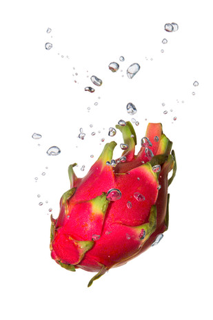 Dragon fruit in the water with air bubbles