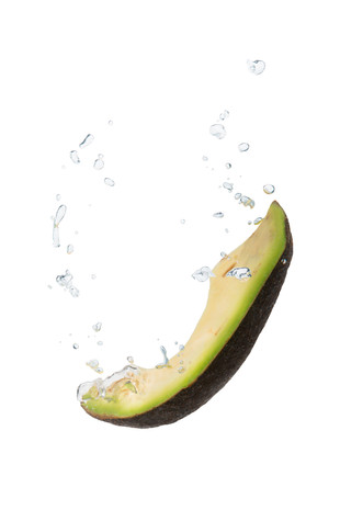 Avocado in the water with air bubbles