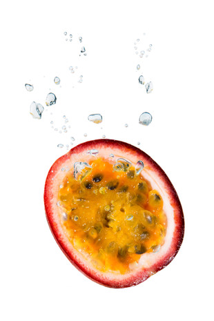 Passion fruit in the water with air bubbles