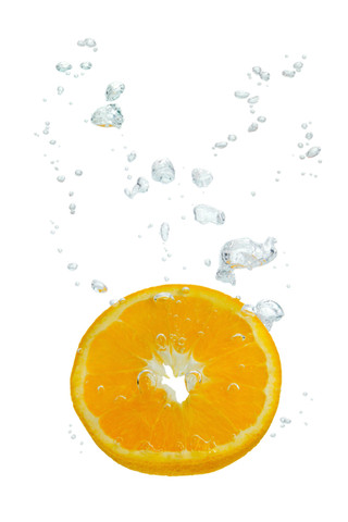 Orange in the water with air bubbles