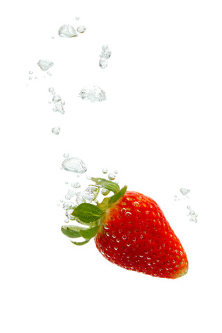 Strawberry in the water with air bubbles