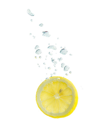 Lemon in the water with air bubbles