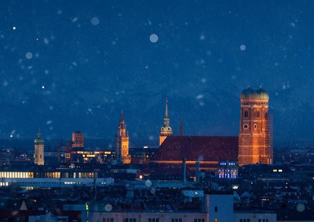 Munich skyline with Frauenkirche in snow