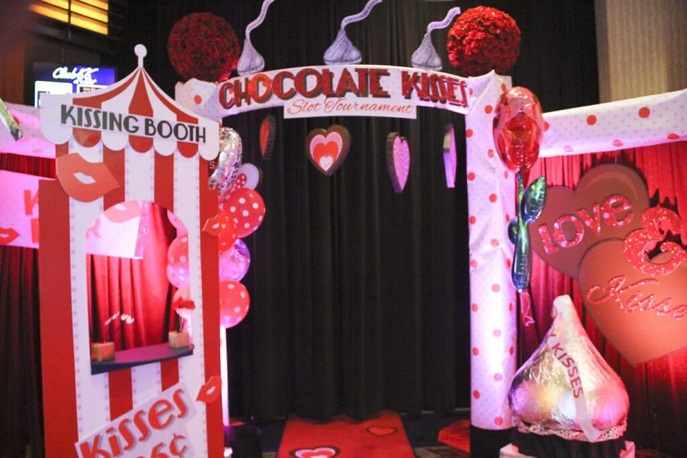 valentines day props including kissing booth and chocolate kisses props