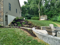 New patio to the right, new installation to the left