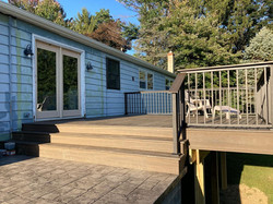 """Beautiful deck with a """"drink rail"""" - the railing is wide enough on top to hold a beverage or several"""