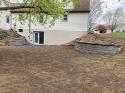 Two new retaining walls and the foundation ready for a patio