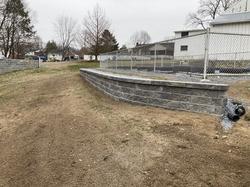 "Versa Lok retaining wall in ""antique gray"" around a pool"