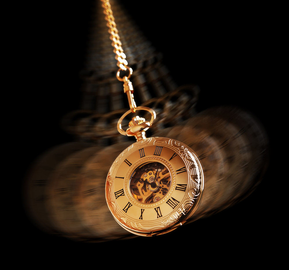 Hypnotism concept, gold pocket watch swinging used in hypnosis treatment.jpg