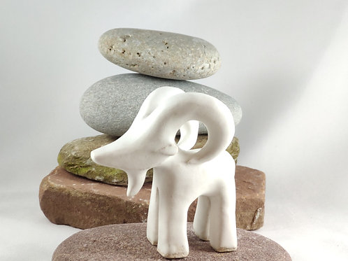 Ibex figurine glazed in matte white. Facing left.