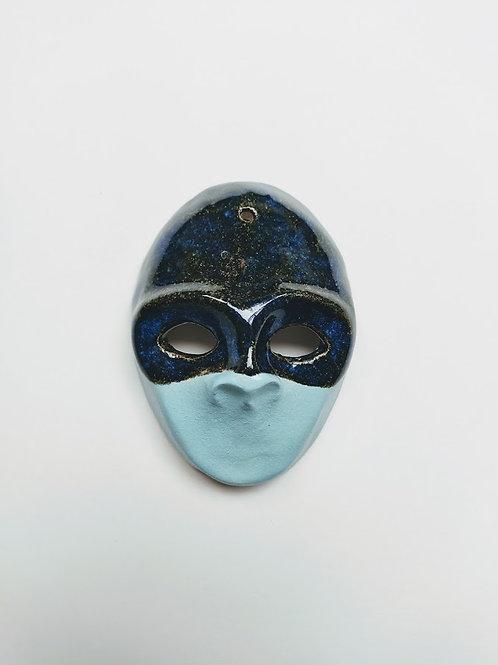 Decorative figure with lapis effect mask
