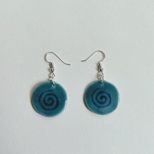Circle earring, cobalt glaze spiral on teal glaze background.