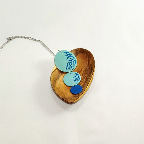 Small trinket dish with rounded edges. Multi-hued cherry grain. Pictured with ibex art pendant necklace.