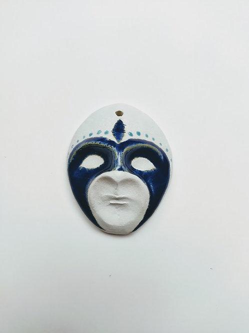 Decorative figure with blue mask