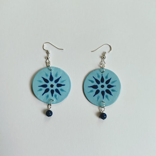Circle earrings with light blue background, flower decoration in cobalt and teal glaze, lapiz lazuli sphere bead