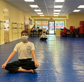 Blackbelt meditating - cropped.jpg