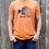 man wearing burnt orange sunny day sunfish shirt