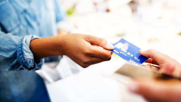 marquee-merchant-woman-passingcard-1600x
