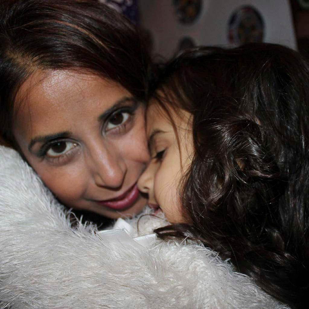 Proud mother to daughter, Eva