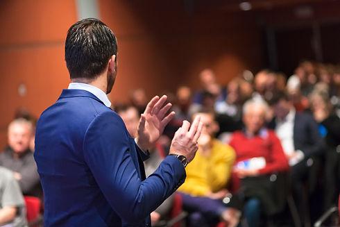 Public speaker giving talk at Business E