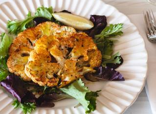 Grilled Cauliflower Steak over Spring Greens