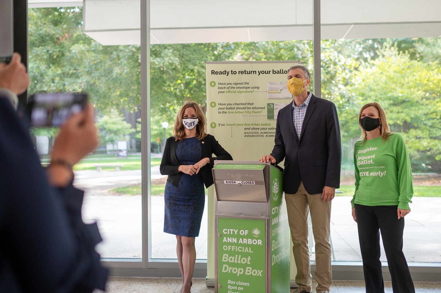 Michigan Secretary of State Jocelyn Benson, Ann Arbor Mayor Christopher Taylor and Ann Arbor City Clerk Jackie Beaudry on our opening day.