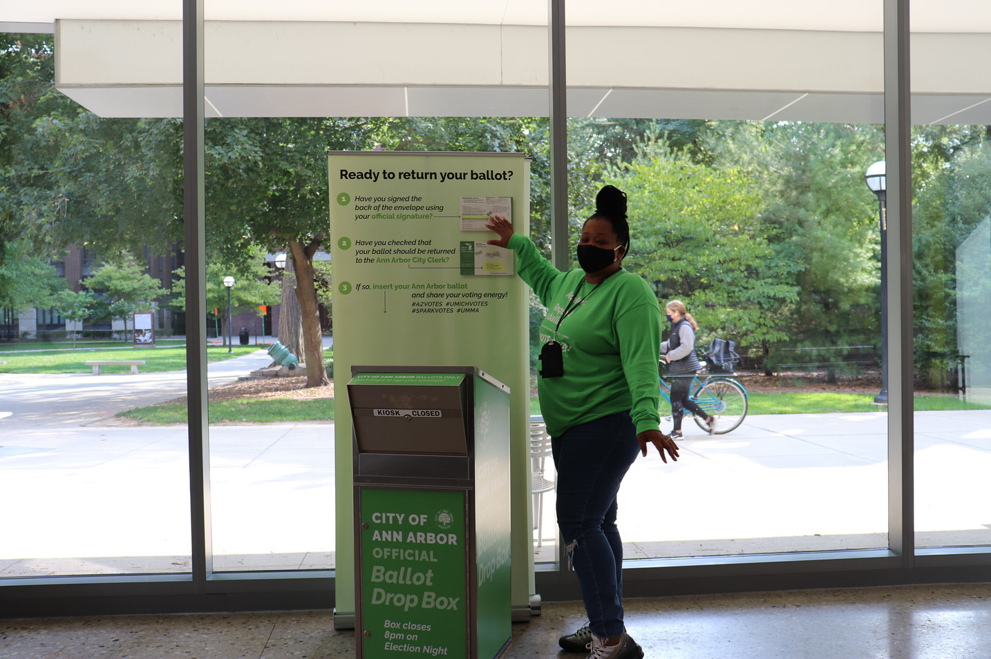 A banner next to the ballot box reminded visitors to sign their ballot envelope before depositing it. (The design was so successful at reducing the number of unsigned envelopes that the City Clerk replicated our set up at City Hall!)