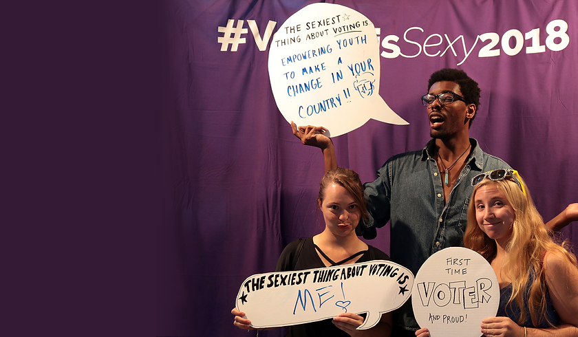 students with creative whiteboard speech bubbles the sexiest thing about voting.png