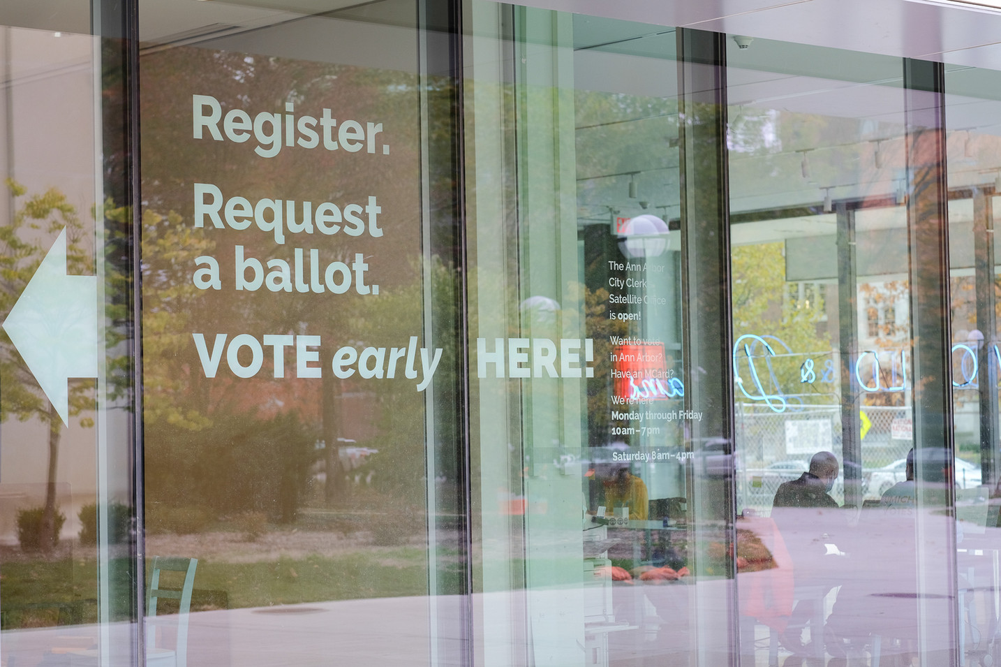 Register. Request a ballot. VOTE early HERE! was our branding identity for the project. This language, used here in window graphics, both publicized the office and made Michigan's new streamlined voting process explicit.
