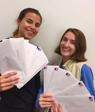 Registration Mentors pose with envelopes filled with students' voter registration forms to be sent