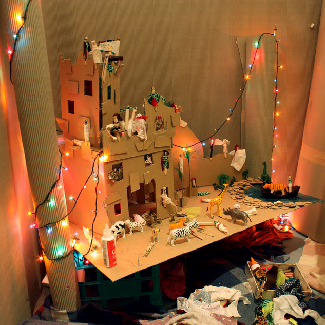 Cardboard castle with materials provided for public to create contributions with.