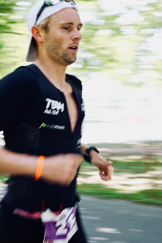 TeamAllOut triathlete running at Ironman Austria