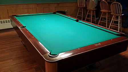 9ft Billiard Table, chairs in background.