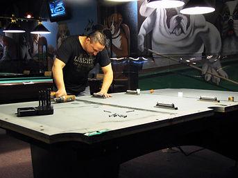 Jeff repairing billiard table.