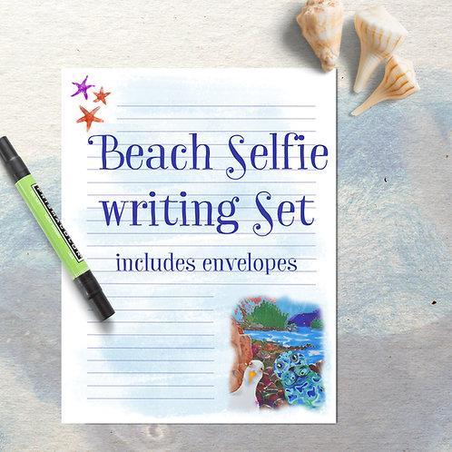 writing paper beach selfie