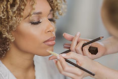 Beautiful bridal makeup being professionally applied.