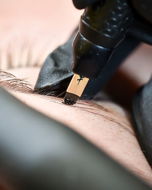 Microblading eyebrows, getting facial care and tattoo at beauty salon.jpg