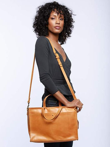 woman wearing able work tote