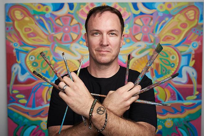 john bukaty painter holding paintbrushes
