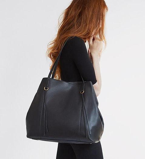 woman wearing hobo handbag
